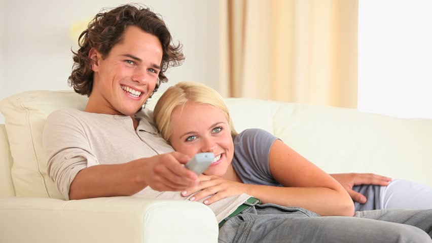 Cute couple watching TV in the living room