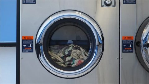 public laundromat washer with clothes inside