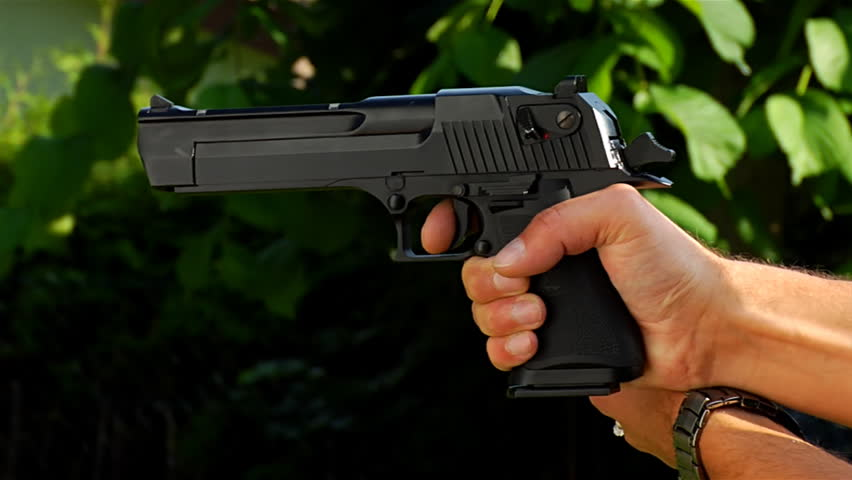 slow motion of a young person shooting with air-soft gun replica