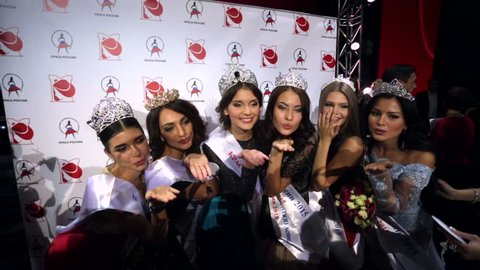 "MOSCOW, RUSSIA - NOVEMBER 18, 2015: Beauty contest winners in various categories send kisses to cameras. An annual national pageant  ""Krasa Rossii"" (The Beauty of Russia)."
