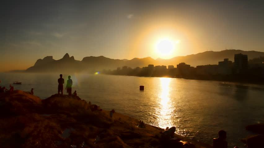 RIO DE JANEIRO, BRAZIL - JUNE 26: Tourists and locals watch sunset at Ipanema Beach, Rio de Janeiro, Brazil June 26 2011. Ipanema is the second most affluent neighborhood in Rio after Leblon,