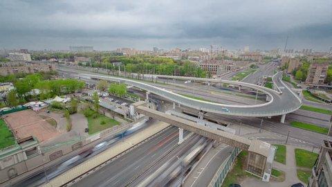 Top view of urban transport traffic on Leningradskoye shosse with overpass to begovaya timelapse. Leningradskoye Highway is a part of M10 federal highway Moscow to Saint Petersburg inside Moscow
