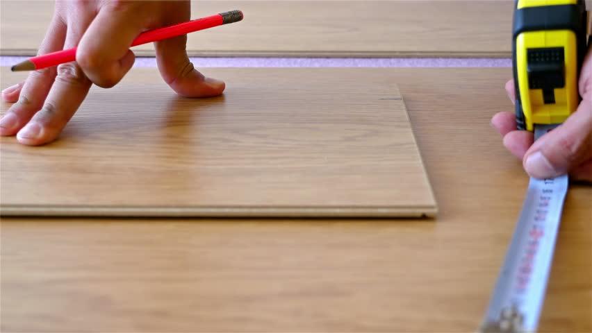 Stock Video Of Man Installing Laminate Flooring 12998786