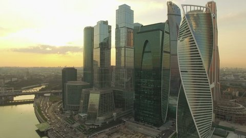 Aerial real time sunset video of Moscow International Business centre. The camera is approaching to the skyscrapers. The concept of business success. 4K, Ultra HD video, DJI Phantom 3 pro.