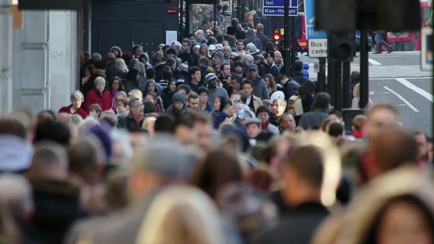 London, Nov 2015: After years of economic downturn, retail areas like Oxford street are once again packed with thousands of people out spending money in the capital's shops. Every age & race are here.   Shutterstock HD Video #13021256