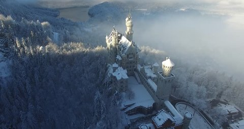 Aerial view of  Neuschwanstein Castle at sunrise in winter landscape. Germany