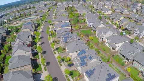 CIRCA 2015 - An aerial image over a vast subdivision of housing units in a neighborhood.