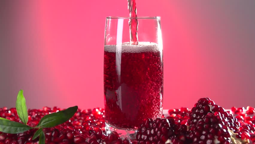 Pomegranate Juice Slow Juicer : Pomegranate Stock Footage video Shutterstock