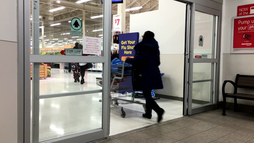 Coquitlam BC Canada - November 10 2015 : People with Shopping Cart Walking & People With Shopping Cart Walking Through The Doors At Superstore ... Pezcame.Com
