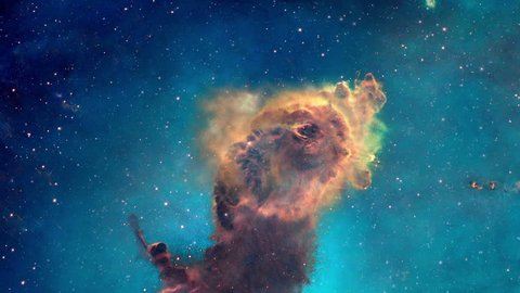 The viewer looks at a portion of the Carina nebula from different angles, its pillars of gas and dust can be seen in three dimensions.  Original image used with permission from NASA's Hubble site.