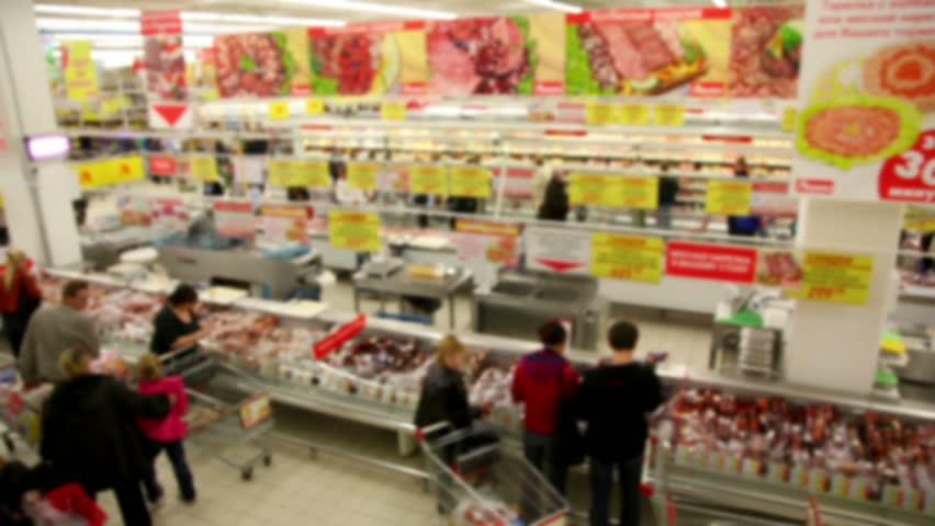 People make purchases at the store, the camera moves along the supermarket  | Shutterstock HD Video #1308526
