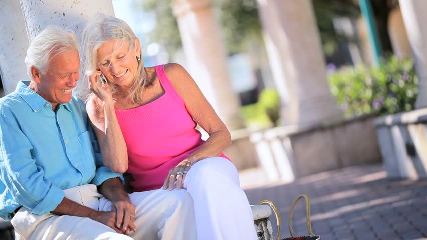 Attractive senior couple on cellphone