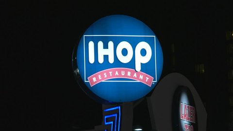 Niagara Falls, Canada - November 30, 2015: IHOP Restaurant Sign Spinning at Night in Niagara Falls.