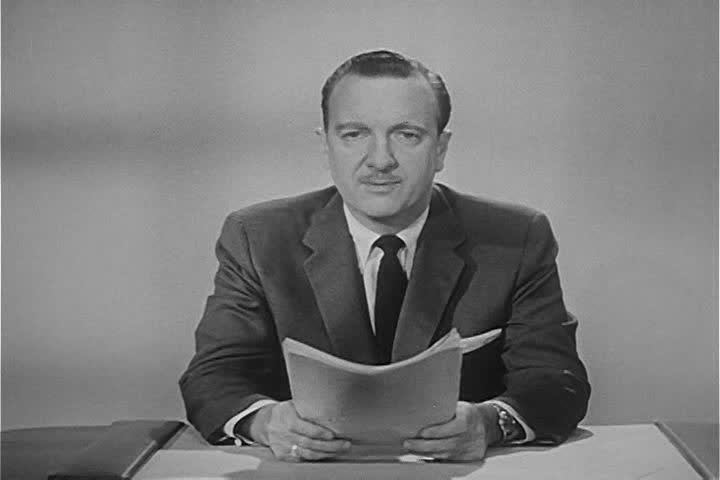 CIRCA 1950s - Walter Cronkite closes a broadcast in the 1950s.