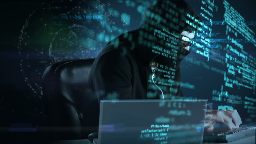Composite video of hacker using laptop with data on background | Shutterstock HD Video #13124696