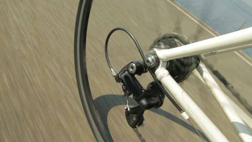 Detail view on a gear system of a racing bike riding on a bicycle path in the country. | Shutterstock HD Video #1313956