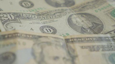 Twenty dolar paper money banknotes in the row slow tilt 4K 2160p 30fps UltraHD footage- Lot of 20 USA dollar banknotes close-up 4K 3840X2160 UHD video
