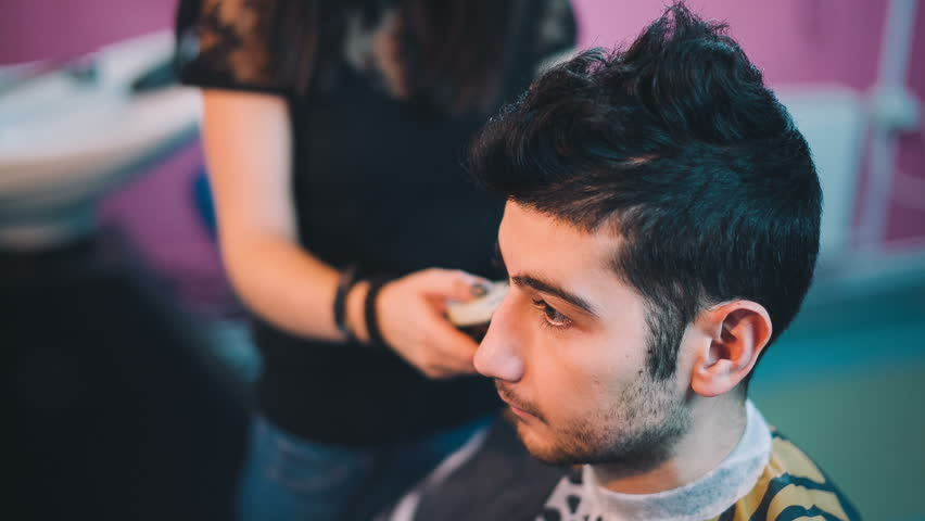 Barber cuts the hair of the client with clipper.   Shutterstock HD Video #13163546