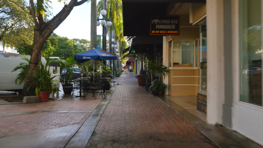 HOLLYWOOD - DECEMBER 2: Stock video of Downtown Hollywood Boulevard which is lined with shops and restaurants just west of Young Circle December 2, 2015 in Hollywood FL, USA | Shutterstock HD Video #13181816