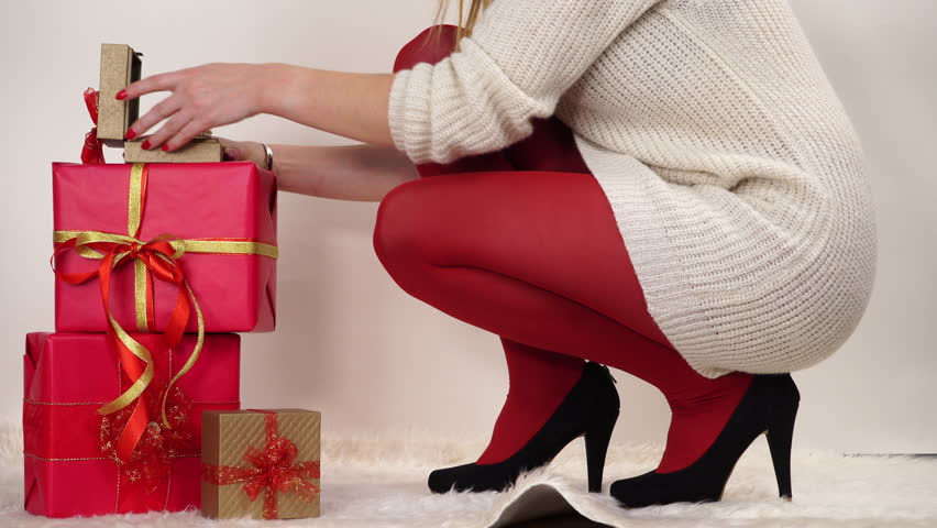 Woman In High Heels Shoes And Red Pantyhose Opening Gift Present ...
