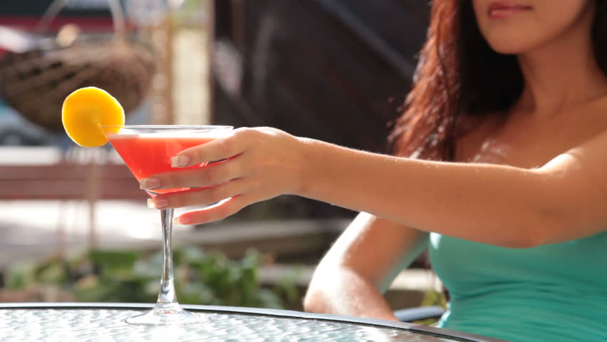unrecognizable woman drinking cocktail in restaurant