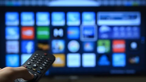 Smart tv with apps and hand.
