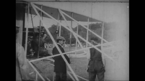 """CIRCA 1900s - Orville Wright and Lt. Frank P. Lahm, the first Army passenger, test the """"Wright Flyer"""" during trials at Fort Myer in 1909."""