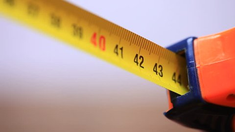 Roll of measuring tape on white background - macro