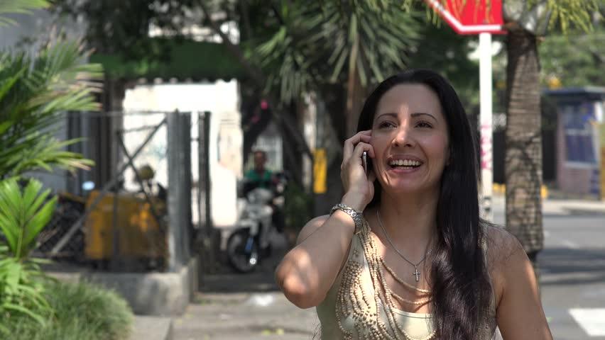 Hispanic Woman Talking on Cell Phone | Shutterstock HD Video #13325666
