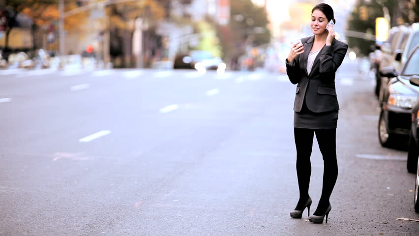 Smart young businesswoman talking on a cell phone on the streets of New York | Shutterstock HD Video #1334659