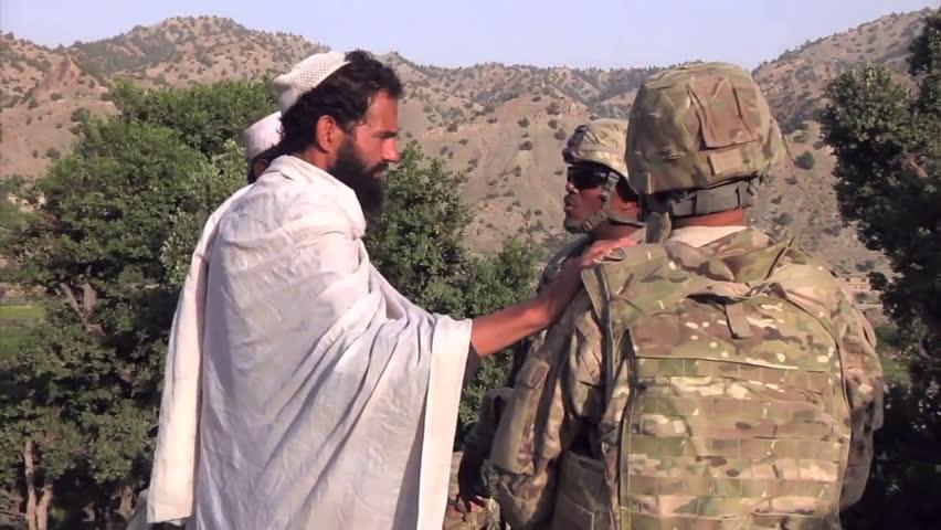 CIRCA 2010s - American soldiers go on patrol in remote Afghan villages.