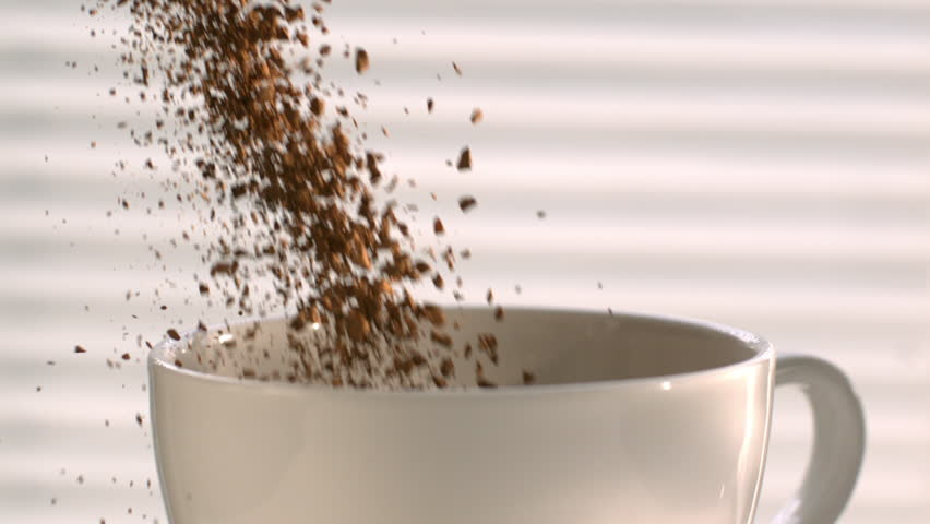 Coffee Pouring into a White Cup in Slow Motion, Instant Coffee Falling into a Cup in High Speed Motion | Shutterstock HD Video #13358132