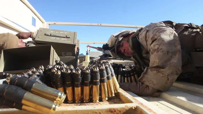 CIRCA 2010s - Marines battle Afghan enemies from a rooftop.