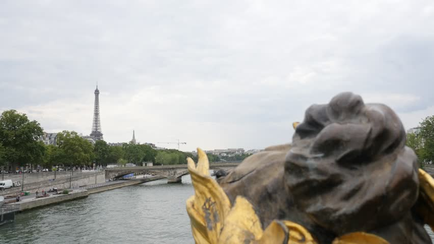 Eiffel tower from Alexander III bridge golden statues Paris France 4K 2160p UltraHD tilt footage - Paris and French sight by the day slow tilting  4K 3840X2160 30fps UHD video | Shutterstock HD Video #13361606