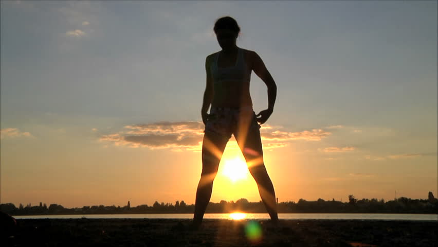 girl is engaged in martial arts at sunset 2