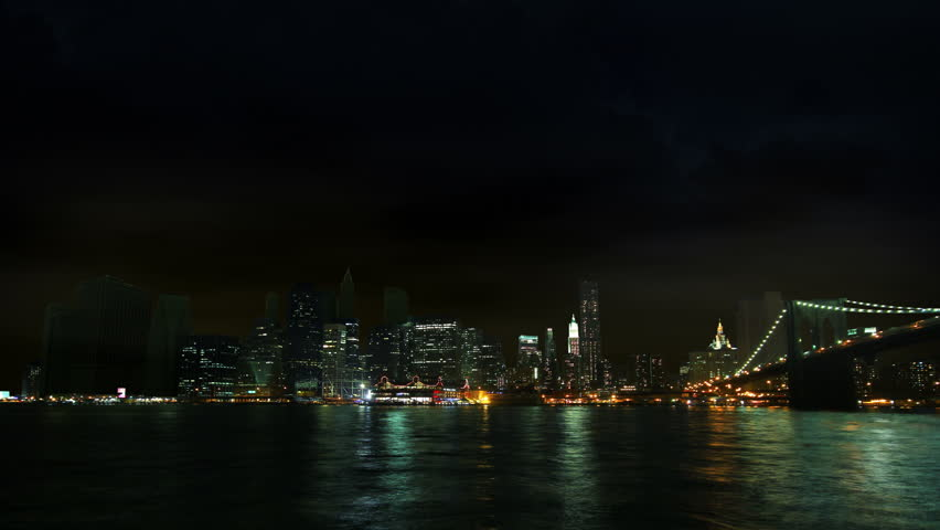 Time-lapse of New York City Skyline (south street seaport) at stormy weather, night shot