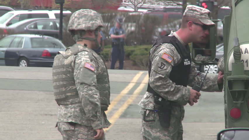 CIRCA 2010s - Neighborhoods are under siege as the Boston Marathon terrorists are hunted down.