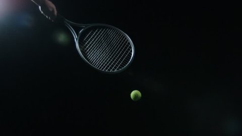 Isolated Tennis ball hit with racquet in slow motion