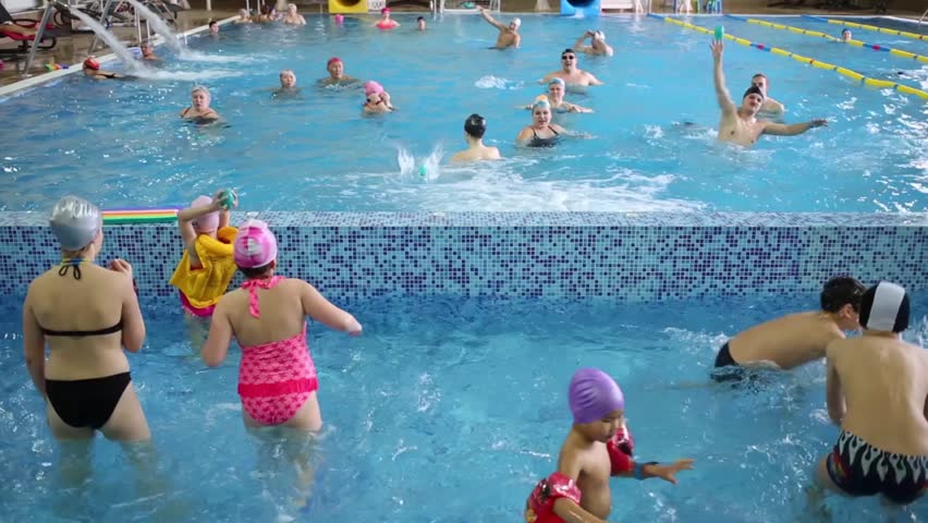Hotel pool with people  LECHISCHEVO, RUSSIA - FEB 23, 2015: People Play In Indoor Pool In ...