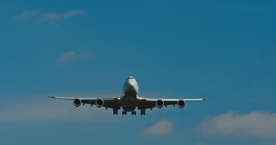 Boeing 747 from the front landing at an Airport