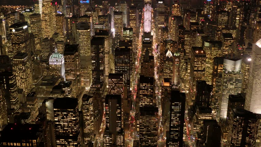 Aerial view of new york city skyline buildings at night. urban metropolis background. establishment shot of nyc.