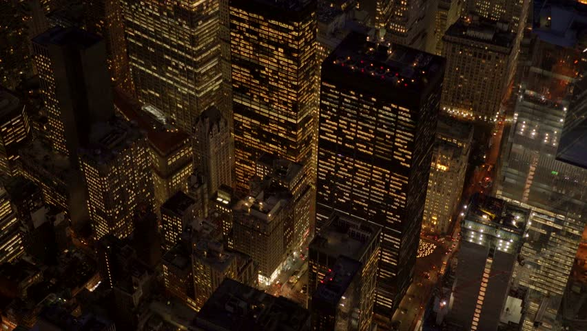Aerial shot of new york city skyline at night. iconic metropolis urban background. high rise business building district