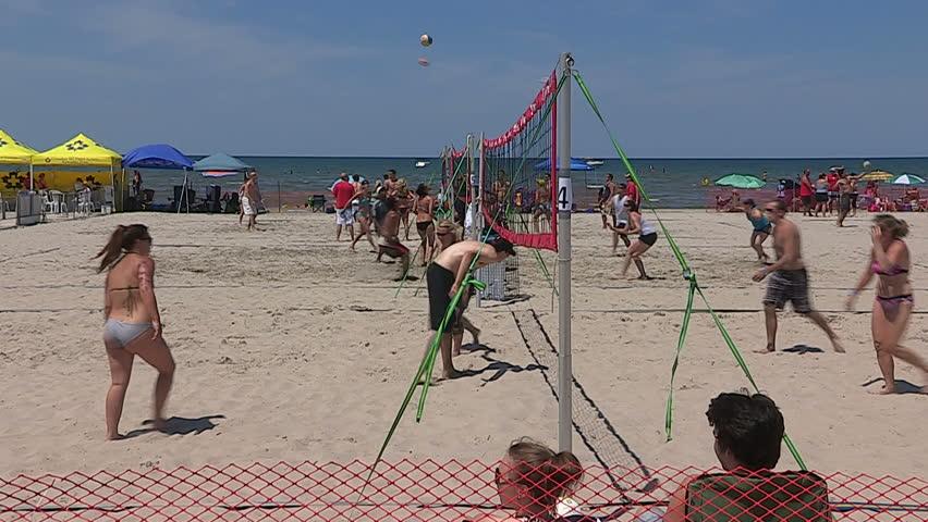 Wasaga beach, Ontario, July 2013 Scorching hot summer beach scenes on sand and water at Wasaga beach Canada