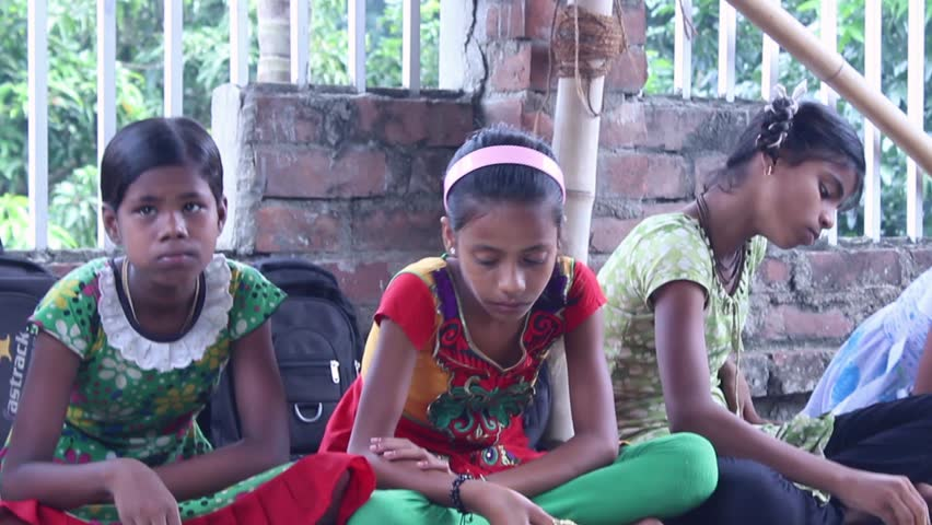 Girlstudents eating vegetarian food at a village school  in India
