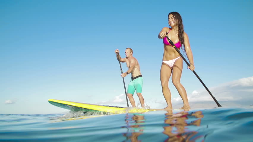 Active Couple Stand Up Paddling In Hawaii, Summer Sport