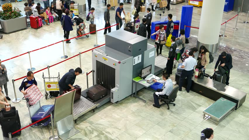Macau February 24 2015 Unidentified Passengers Put Bags And Suitcases On Security Scanner