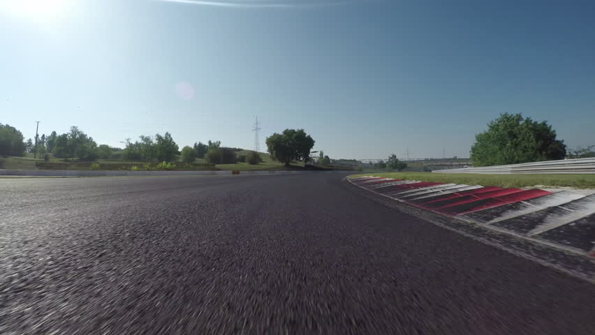 LOW ANGLE VIEW: Race car competing and driving fast on race track lap | Shutterstock HD Video #13683314