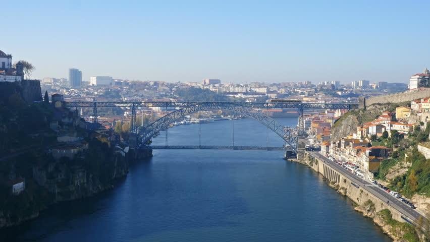 Luis I bridge and moving train, Douro river, Porto, Portugal   | Shutterstock HD Video #13686806