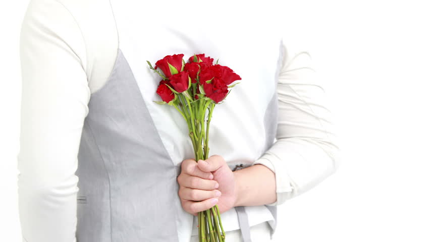 Man offering flowers to his girlfriend on white background | Shutterstock HD Video #13692266