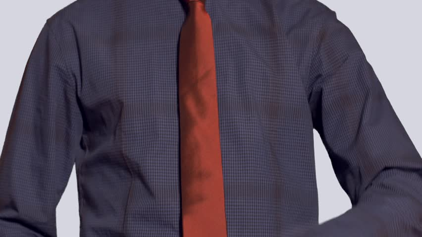 Business man tying a tie stock footage video 4466447 shutterstock business man in dress shirt and tie raises smart watch and interacts 4k stock video ccuart Choice Image